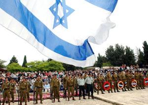 דגל מתנופף בטקס יום הזיכרון